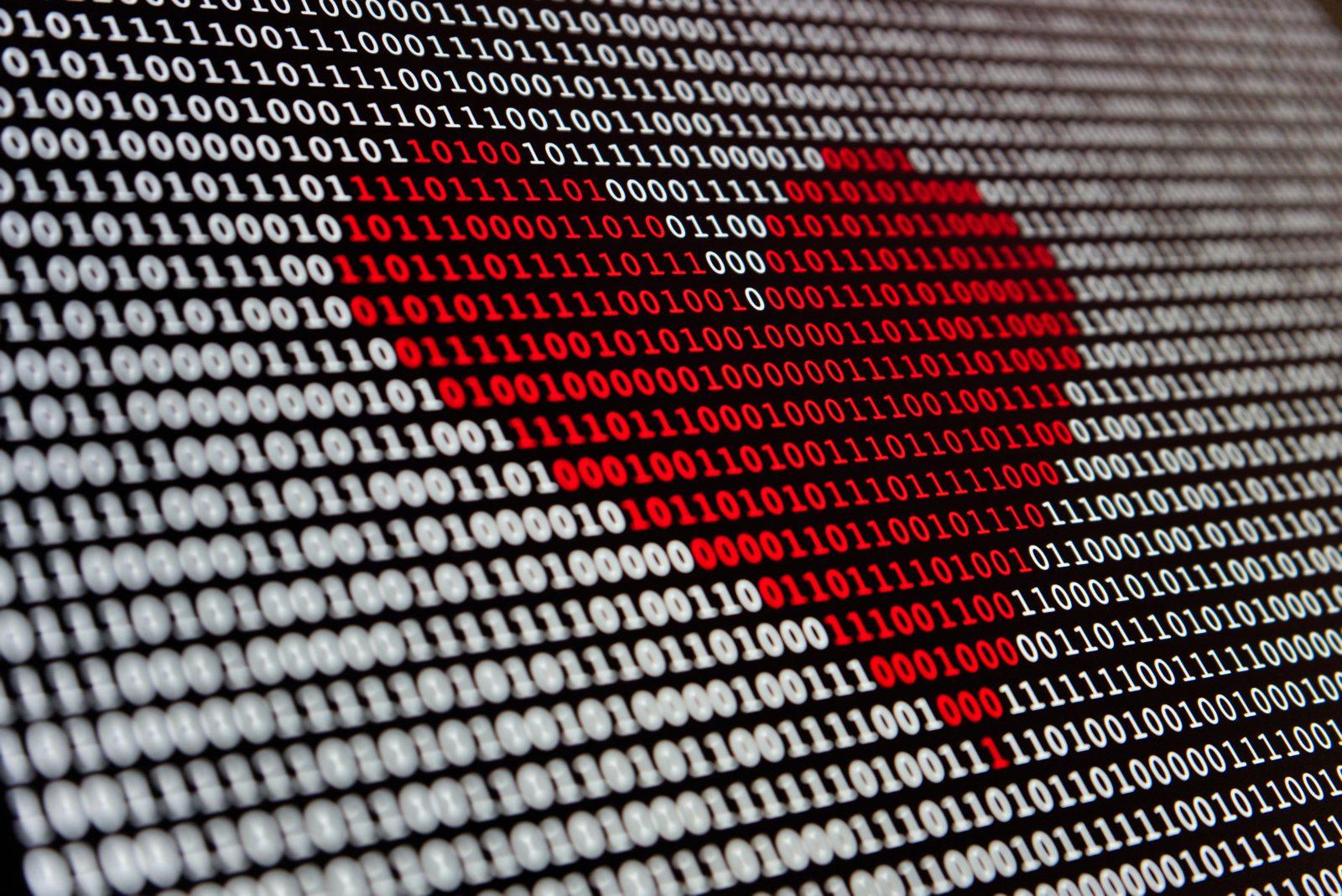 ett rött hjärta av enor och nollor