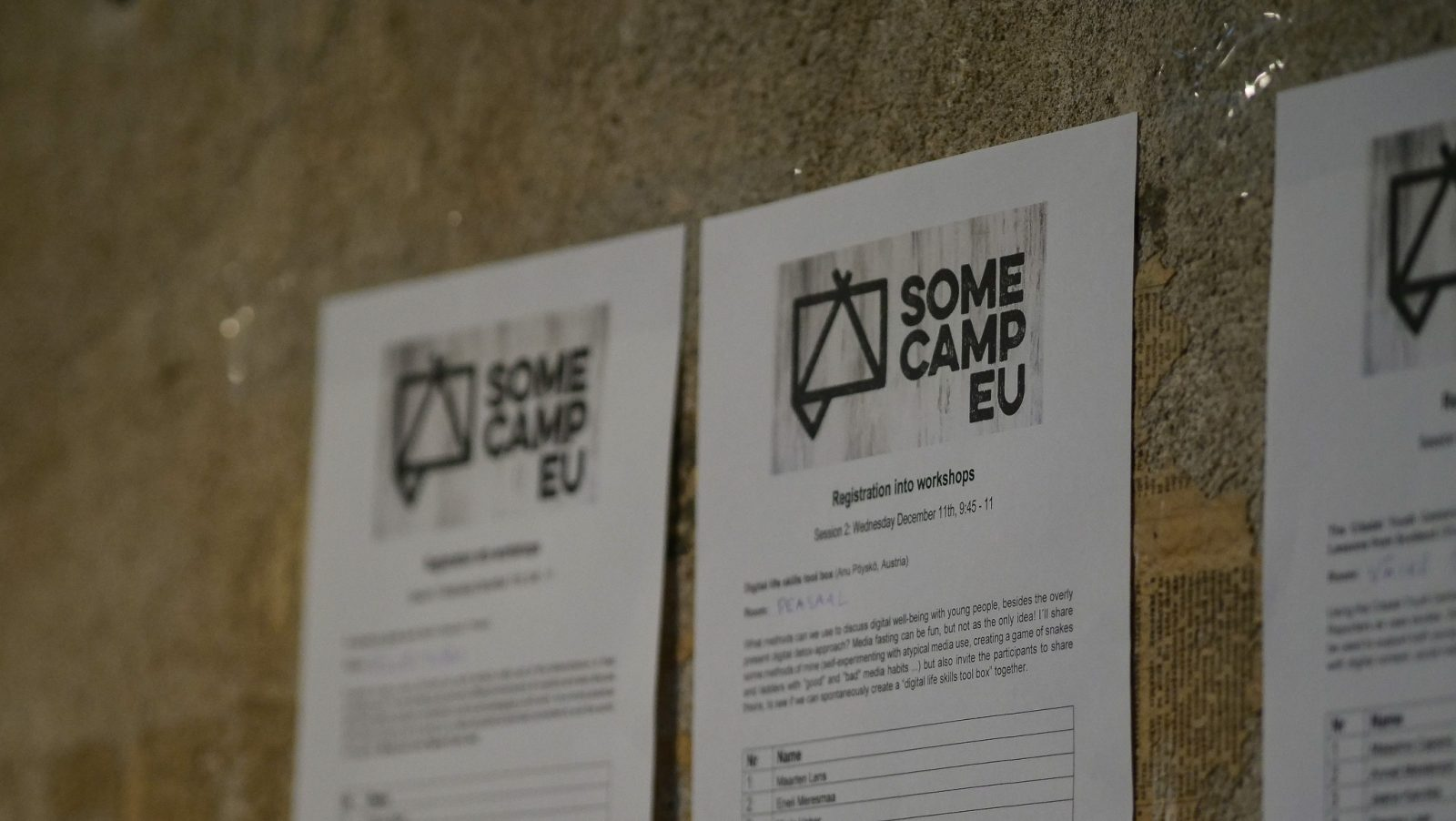 photo of a registration sheet hanging on the wall at the Somecamp EU event